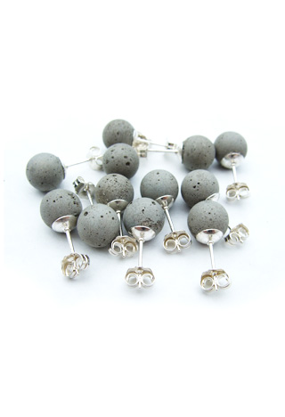 "A handful of earrings that feature concrete ""pearls"" on sterling silver posts."