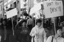 Asian immigrant women garment workers walking the sidewalk, boycotting DKNY.