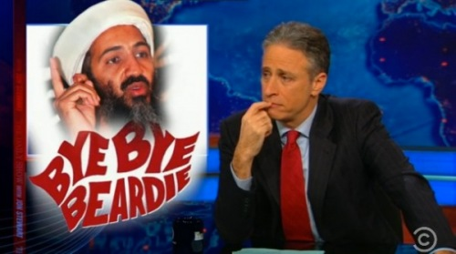 "Daily Show host John Stewart looks at the news graphic of Osama bin Laden above the caption, ""Bye Bye Beardie,"" an allusion to the Broadway musical ""Bye Bye Birdie."""